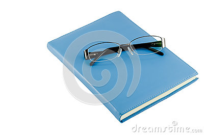 Black glasses on blue diary