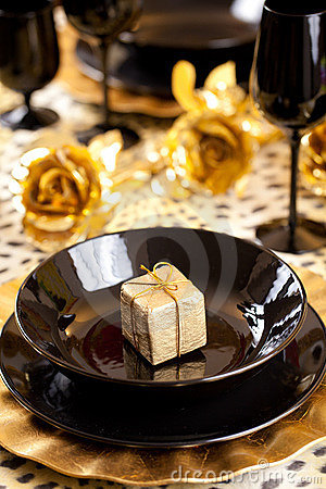 Black and gold place setting and gift box