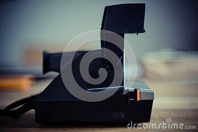 Black And Gray Instant Camera On Brown Wooden Table Free Public Domain Cc0 Image