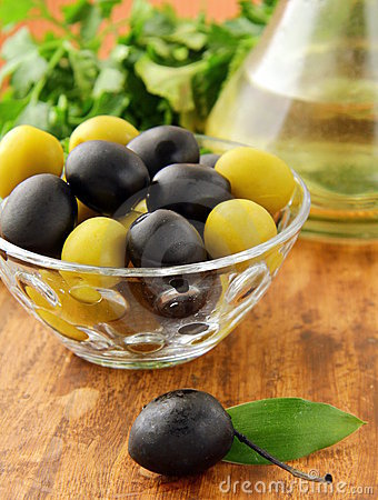 Black and green olives and a bottle of olive oil