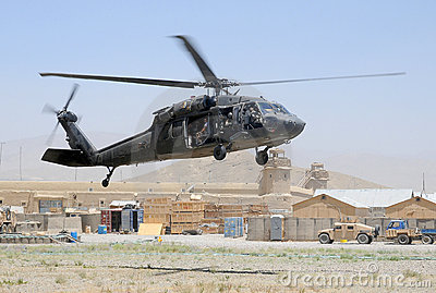 Black Hawk taking off in combat zone Editorial Photography