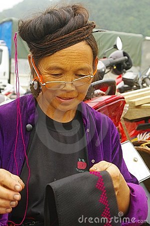 Black Hmong woman embroidering his turban Editorial Stock Photo