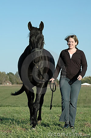 Black horse and woman