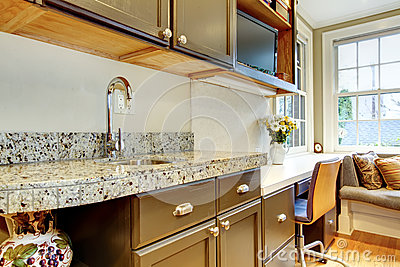 Black kitchen cabinets with marble counter top