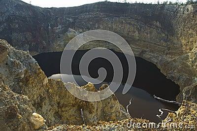 Black lake in volcano crater, kelimutu, flores, indonesia