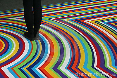 Black legs on Moma multicolor pavement Editorial Stock Photo