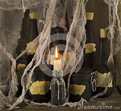 Black magic bottles with candle