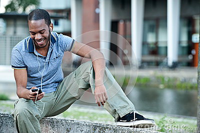 Black Male Listening to Music on Mp3