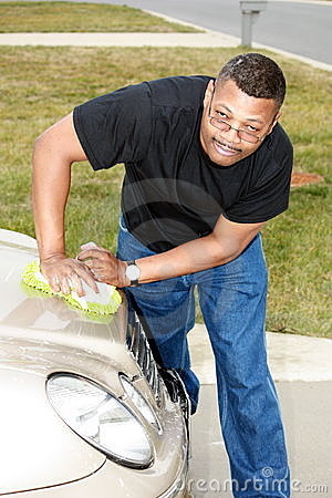 Black man cleaning car
