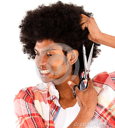 Black man cutting his afro