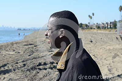 Black Man Gazing Into The Ocean