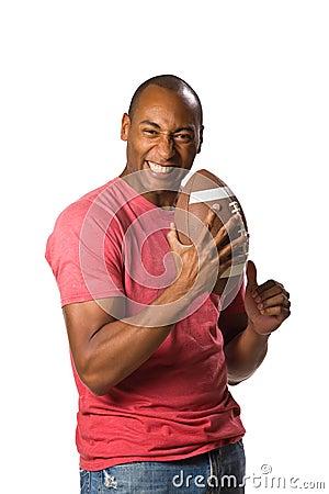 Free Black Man Holding Football Stock Image - 5496981