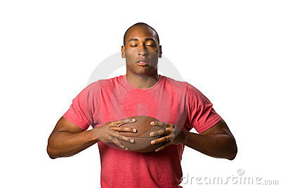 Black Man holding football