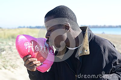 Black Man kissing his valentine