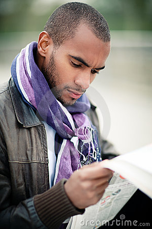 Black man with newspaper