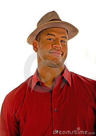 Black Man in a Red Shirt and Brown Hat Smirk