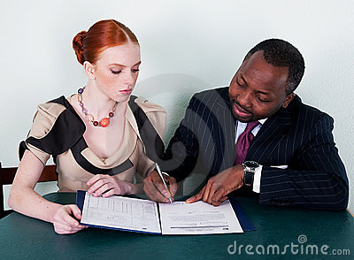 Black man and redhead girl with documentation