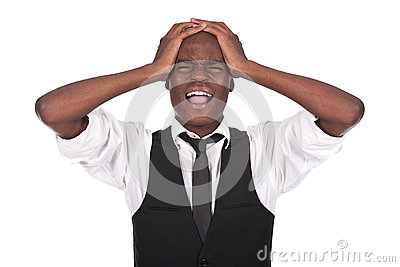 Black man screaming with headache