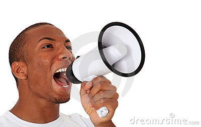 Black man shouting through megaphone