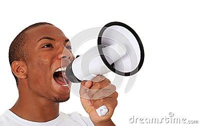 Black man shouting through megaphone