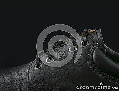 Black men s shoe on black background