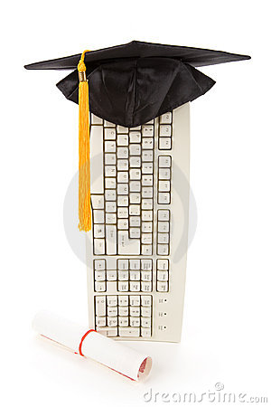 Black Mortarboard and computer keyboard