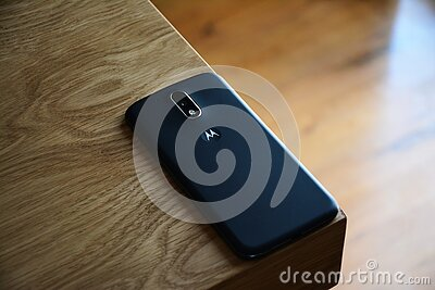 Black Motorola Smartphone On Top Of Brown Wooden Table Free Public Domain Cc0 Image
