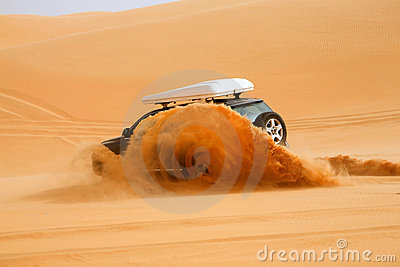 Black off-road car fetching a dune, Libya - Africa