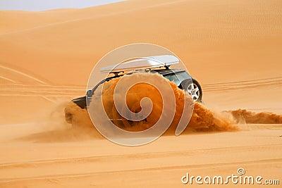 Black off-road car fetching a dune, Libya - Africa