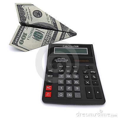 Black office calculator and paper airplane