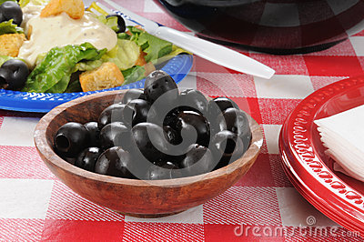 Black olives on a picnic table