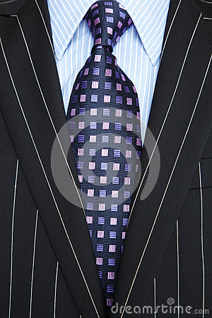 Free Black Pinstripe Suit And Purple Tie Royalty Free Stock Photography - 24709407