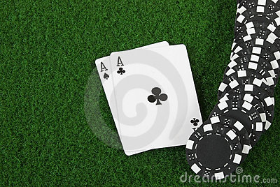 Black poker cihps and two aces