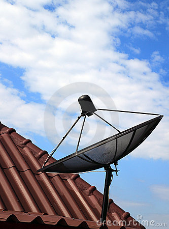 Black satellite dish on  house roof
