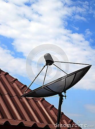 Black satellite dish on  house roof
