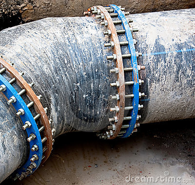 Free Black Sewer Pipe With Bolt Clamp Stock Photos - 14183593
