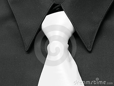 Black shirt. White tie