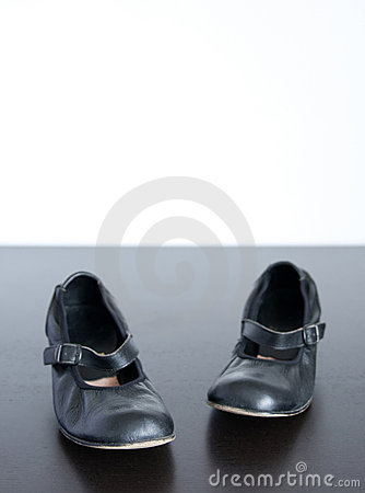 Black shoes on wooden surface