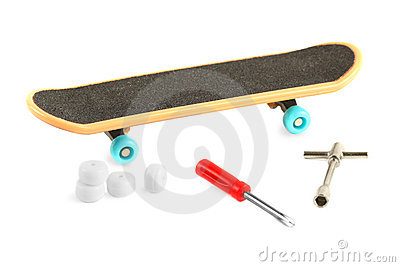 Black skateboard near tools Stock Photo