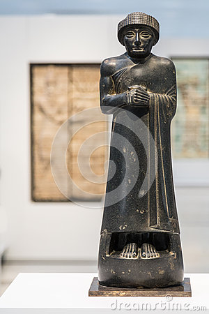 Black statue of a manin the Louvre Lens Editorial Photo