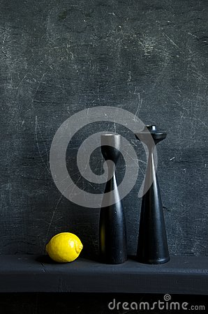 Black still-life with lemon