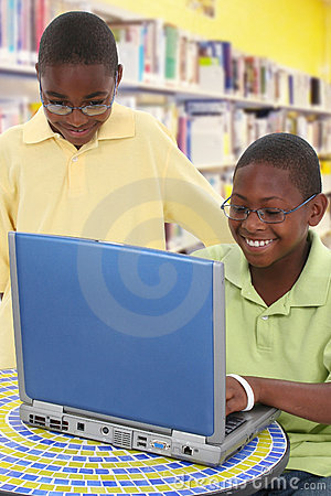 Black Students Sharing Laptop at School
