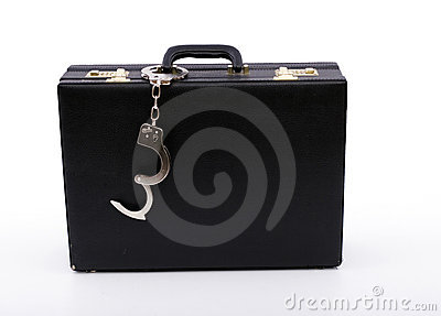 Black suitcase from pinned handcuffs