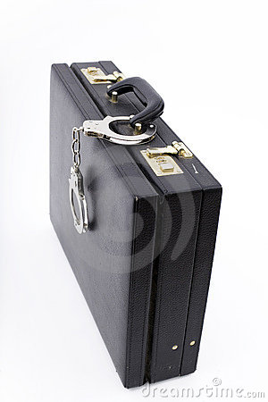Black suitcase from pinned unbuttoned handcuffs