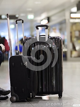 Black suitcases standing airport