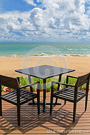 Free Black Table For Two On Wooden Balcony With Blurred Beach And Blu Royalty Free Stock Photography - 76886967