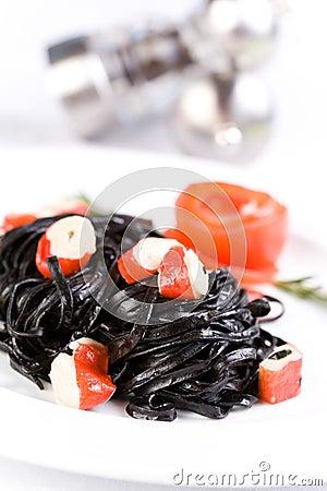 Black tagliatelle pasta with crab cubes
