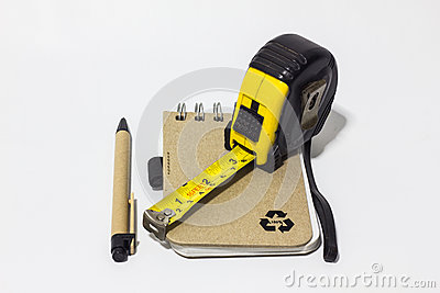 Black tape measure accessories, notebook, pen on background whit