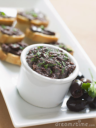 Free Black Tapenade On Toasts Royalty Free Stock Photos - 5950008