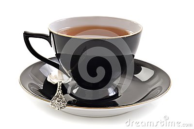 Black tea cup on white